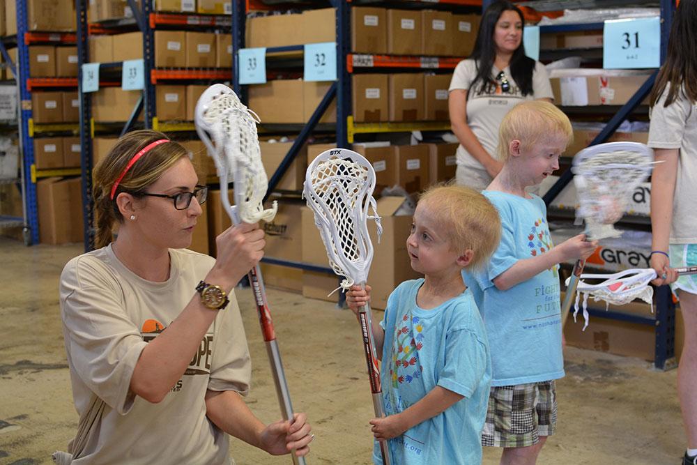 Megan and Bennett learning lacrosse