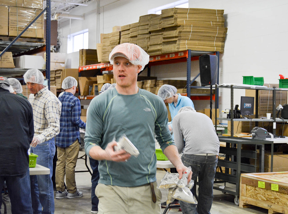 Drew struts around demanding attention with his newsboy style hair net over hat. Nothing will stop this man from feeding kids.